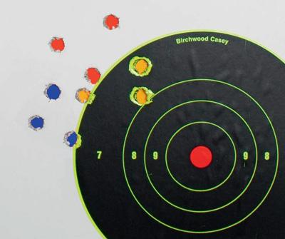 Нафото три группы потри выстрела, каждая изкоторых выполнена разным стрелком. Дистанция 50м. Поперечники около 30мм