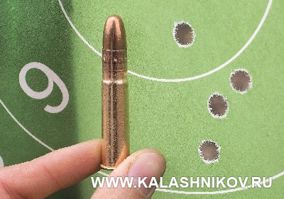 Мишень с рузельтатами стрельбы из ружья ВПО-223 с оптикой. Журнал «Калашников»